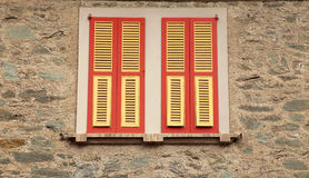 Old red shutter windows in stone house, Italy. Royalty Free Stock Photography