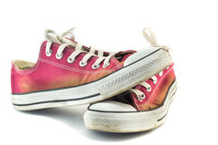 Old red sneakers on white Royalty Free Stock Photos