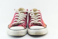 Old red sneakers on white Stock Images