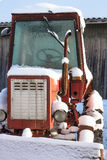The old red snowy tractor Royalty Free Stock Photography
