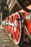 Old red steam locomotive wheels closeup royalty free stock photography
