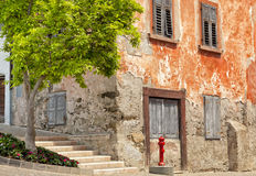 Old red stone house on cobbled historic street Royalty Free Stock Photo