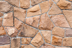 Old red stone wall background texture Royalty Free Stock Photography