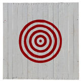 Old red target on white planks background Royalty Free Stock Photography