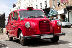 Old red taxi in London. An old red taxi in the streets of London stock images
