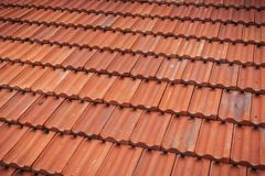 Old red tile in-line roof pattern Stock Photo