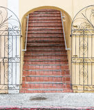 Old Red Tile Steps in Yellow Plaster Building Stock Photos