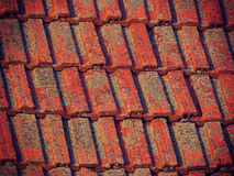 Old red tiles on a house roof Royalty Free Stock Image