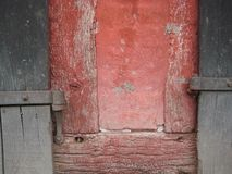Old red timber framed building blue grey doors hinge stock image