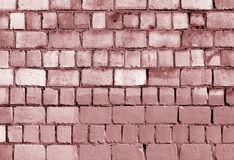 Old red toned brick wall texture Stock Photo