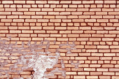 Old red toned weathered brick wall texture. Royalty Free Stock Photo