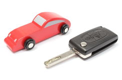 Old red toy car and vehicle key on white background Stock Photos