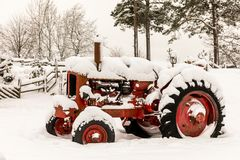 Old Red Tractor Covered In Snow Royalty Free Stock Photography
