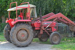 Old red tractor with loader Stock Photos