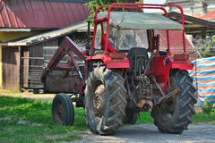 Old red tractor with loader Royalty Free Stock Image
