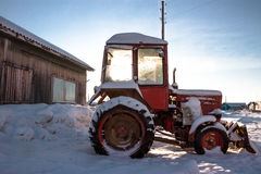 The old red tractor in the village Royalty Free Stock Photography