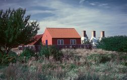 Danish smoakhouse on Bornholm island. Old red traditional Danish smoakhouse on the island of Bornholm, Baltic Sea. Analog photography, slide scan royalty free stock photo