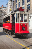 Old red tram goes on Istiklal street Stock Photo