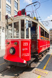 Old red tram goes on the street in Istanbul Stock Photos