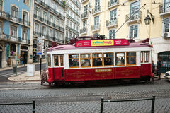 Old red tram in the historic center of Lisbon, Portugal Stock Photos