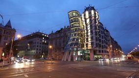 Old red tram is passing Dancing House in Prague. Prague, Czech Republic - October 11 2016: Old red tram is passing Dancing House stock video