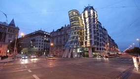Old red tram is passing Dancing House in Prague. Prague, Czech Republic - October 11 2016: Old red tram is passing Dancing House stock video footage