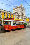 Old red tram at  triumphal arch on the Palace Square in Lisbon Royalty Free Stock Image