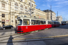 Old red tram waiting for people on the stop Stock Image