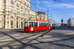 Old red tram waiting for people on the stop Stock Photo