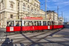 Old red tram waiting for people on the stop Royalty Free Stock Photos
