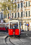 Old red tram waiting for people on the stop Royalty Free Stock Images