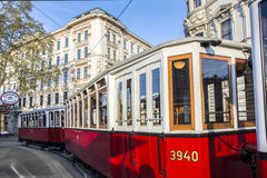 Old red tram waiting for people on the stop Royalty Free Stock Image