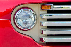 Old red truck headlight Stock Photography