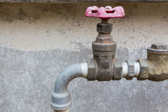 Old red valve with steel pipe. In the factory Royalty Free Stock Photo