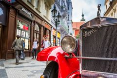 Old red vintage car in downtown of Prague Royalty Free Stock Photo
