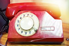 Old red vintage dial telephone. Old red vintage phone with dial royalty free stock photography