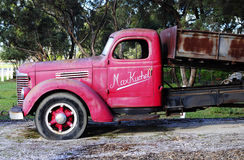 Old red vintage truck at the entrance of Kuchel estate Stock Image