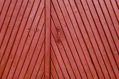 Old red vintage wooden painted door royalty free stock photo