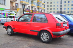 Old red Volkswagen II parked. Back view of old red produced around 1986 Volkswagen Golf II with two doors parked in Gdynia in northern Poland Stock Image