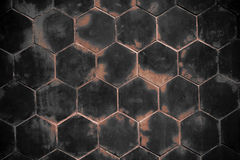 Old red wall with Hexagonal shape Stock Images