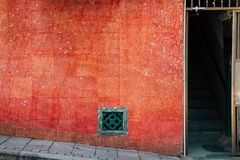 Old red wall and open door in Hong Kong royalty free stock photos