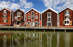 Old red warehouses. Hudiksvall, Sweden - July 5, 2017: Old red warehouses built of wood next to the water Stock Photos