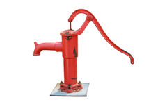 Old red water pump on white background Stock Photos