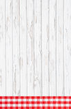 Old red white checked wooden background with fabrics on the fram. Old red white checked and shabby chic wooden background with fabrics on the frame Royalty Free Stock Photo