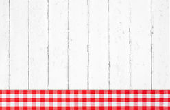 Old red white checked wooden background with fabrics on the fram Stock Images