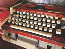 Old red and white typewriter.Vintage type word. Back to the basic royalty free stock image