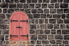 An Old Red Window Barred Royalty Free Stock Photos