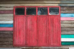 Old Red Window. Red window on colorful walls Royalty Free Stock Images
