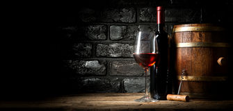 Old red wine. Near black brick wall royalty free stock images