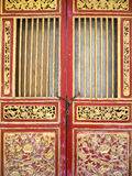 Old red wood chinese style door Royalty Free Stock Images